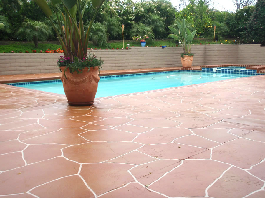 Pool deck concrete resurfacing gives old decks new life for Pool resurfacing